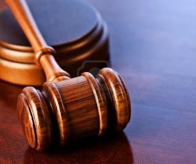 5695719-wooden-judges-gavel-on-a-desk